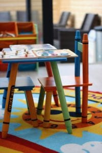 a picture of colourful furniture for children, in childcare facilities in central london