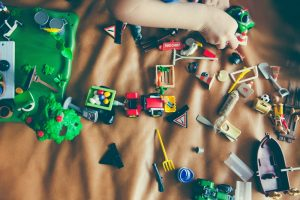 london day care centre; a picture of a child playing with car toys