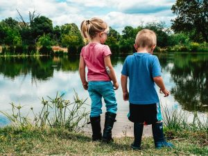 Two Children Together by a pond