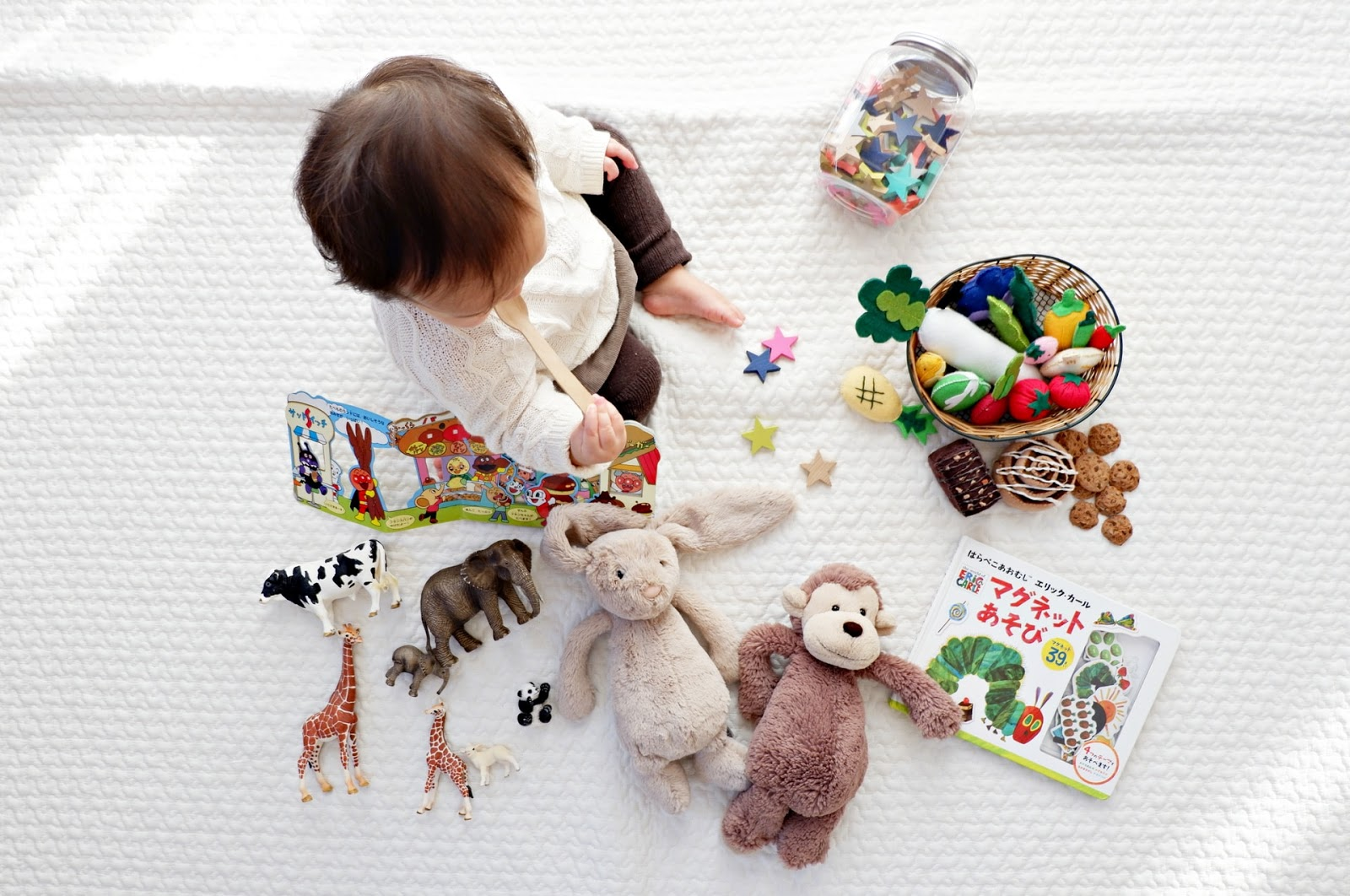 aerial view of child playing with toys