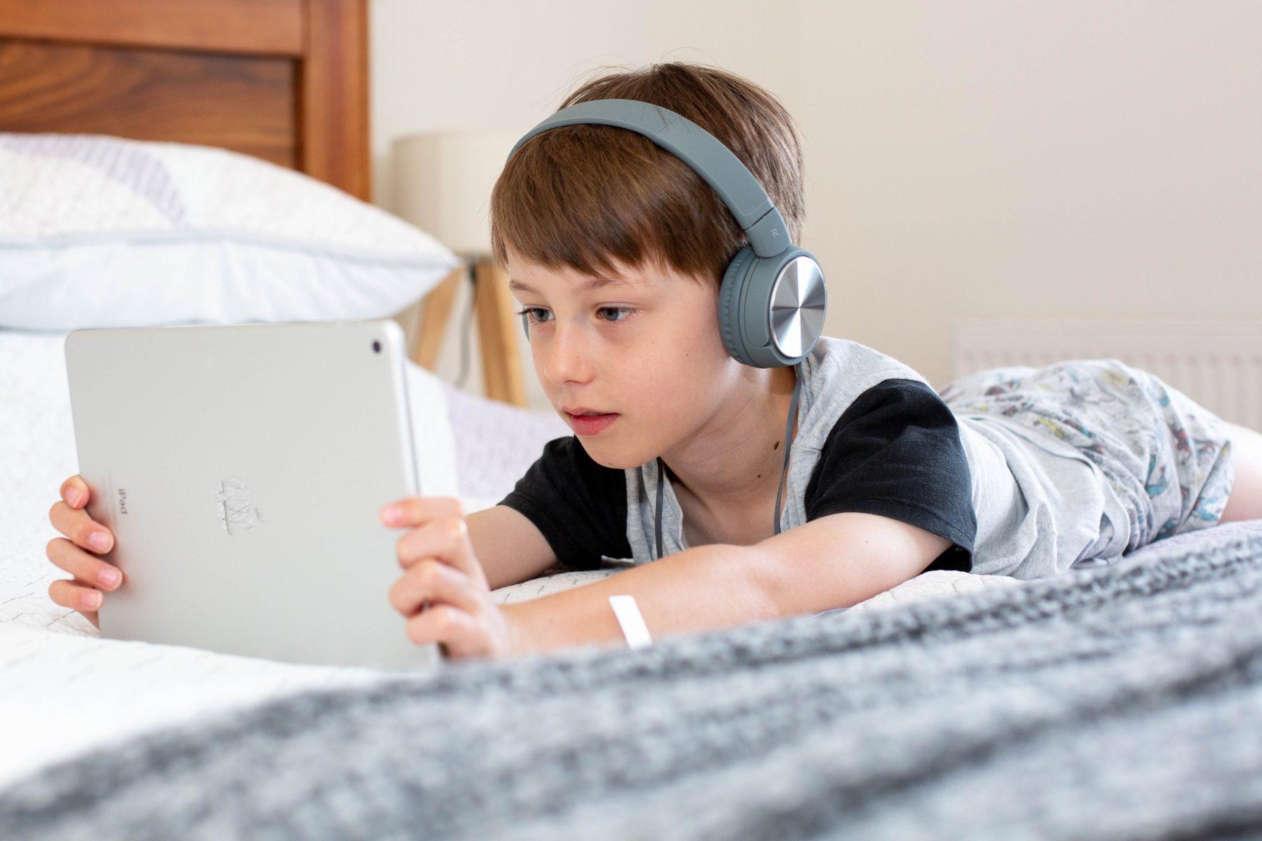 Toddler watching TV on iPad
